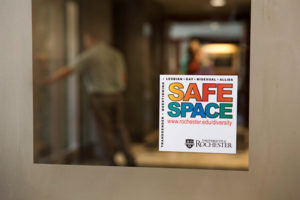 sign in an office door reads SAFE SPACE