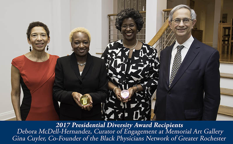 l-r: vice provost for faculty development and diversity Vivian Lewis, winners Debora McDell-Hernandez and Dr. Gina Cuyler, and UR president Joel Seligman. // University of Rochester Diversity Awards are presented at Witmer House January 25, 2017. // photo by J. Adam Fenster / University of Rochester