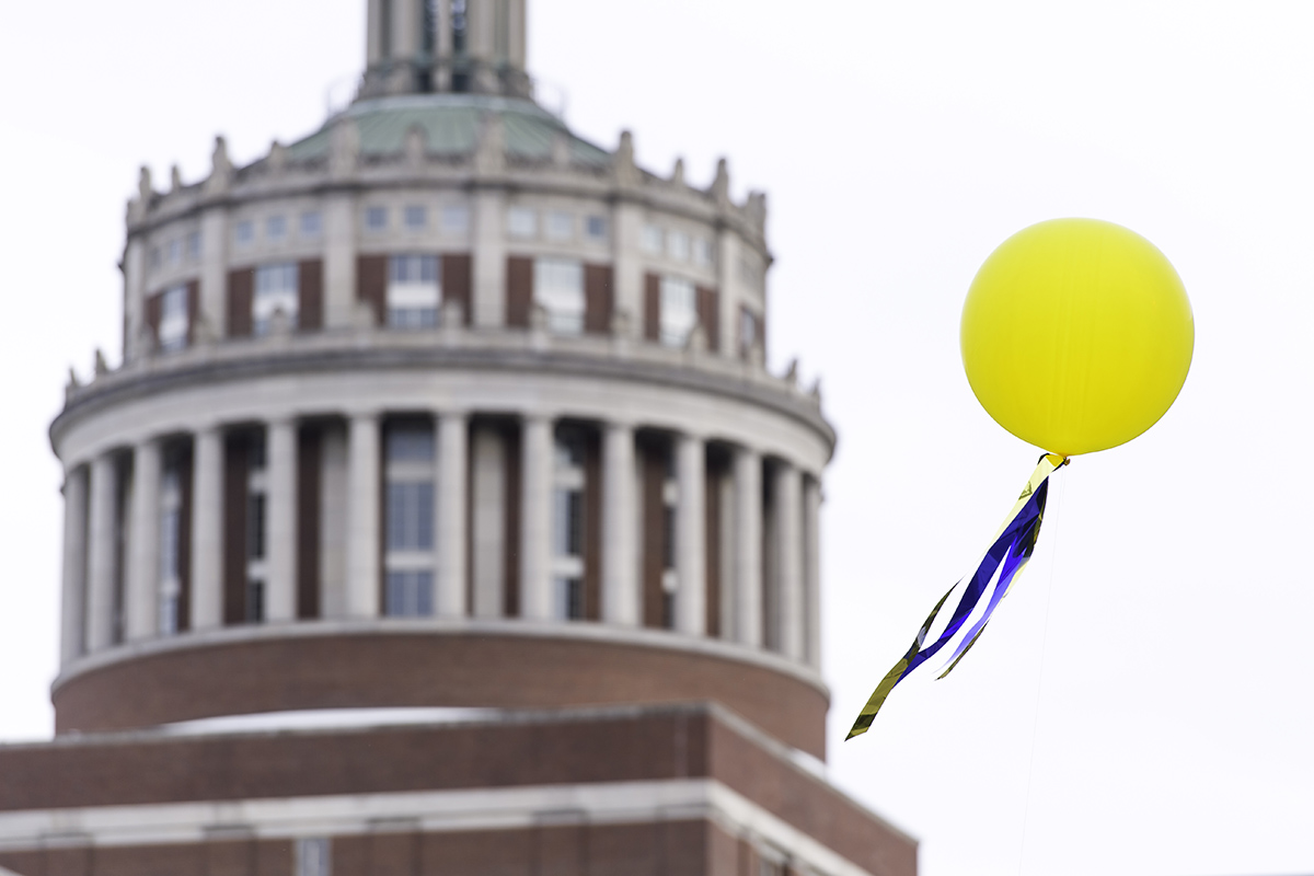 A balloon flies in front of Rush Rhees Library