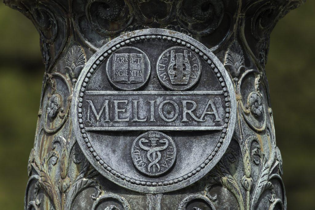 The Meliora seal on the University flagpole