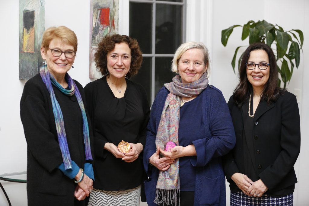 University of Rochester President Sarah Mangelsdorf is posing with three Presidential Diversity Award recipients.
