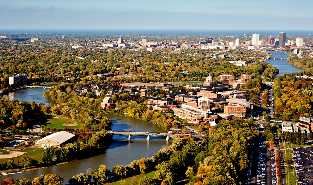 aerial photograph of River Campus and the city of Rochester skyline