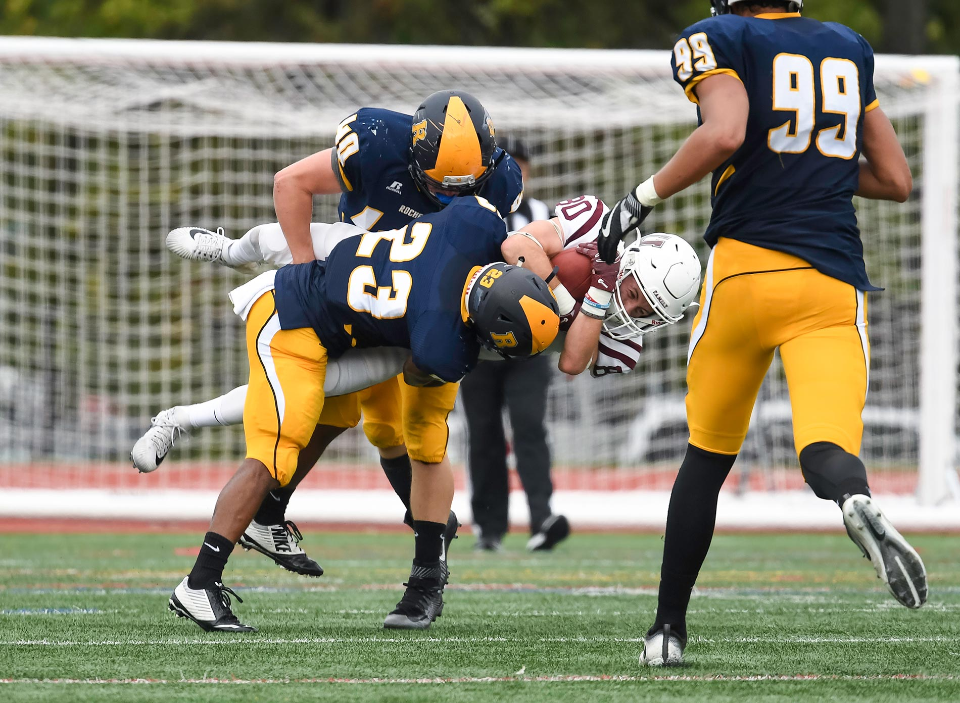 University of rochester two football players tackling another football player fandeluxe Gallery