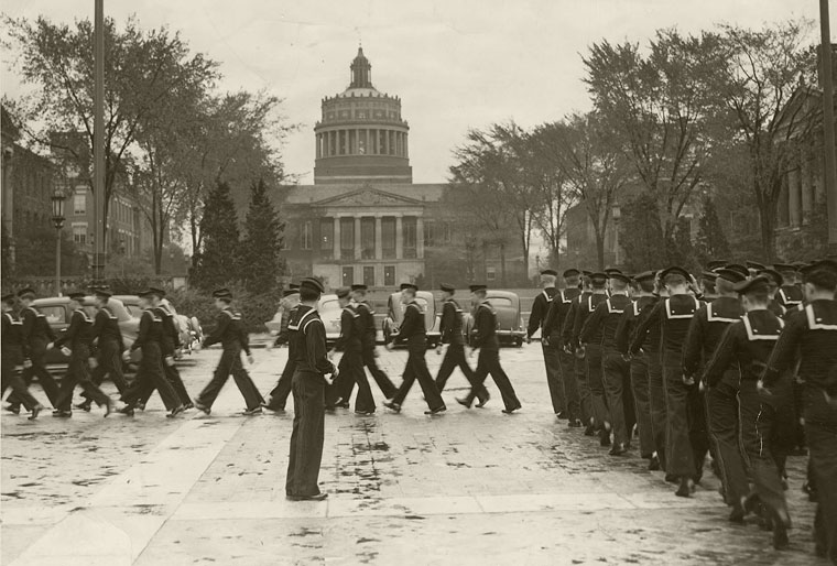 navy sailors march past Rush Rhees Library