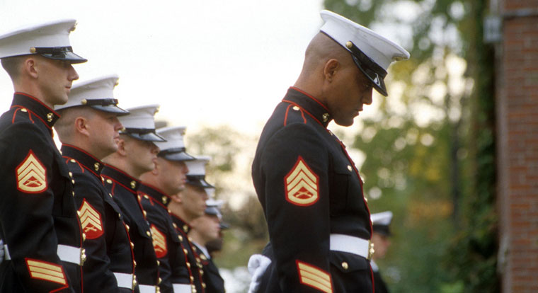 Marine sargeants bowing their heads during ceremony