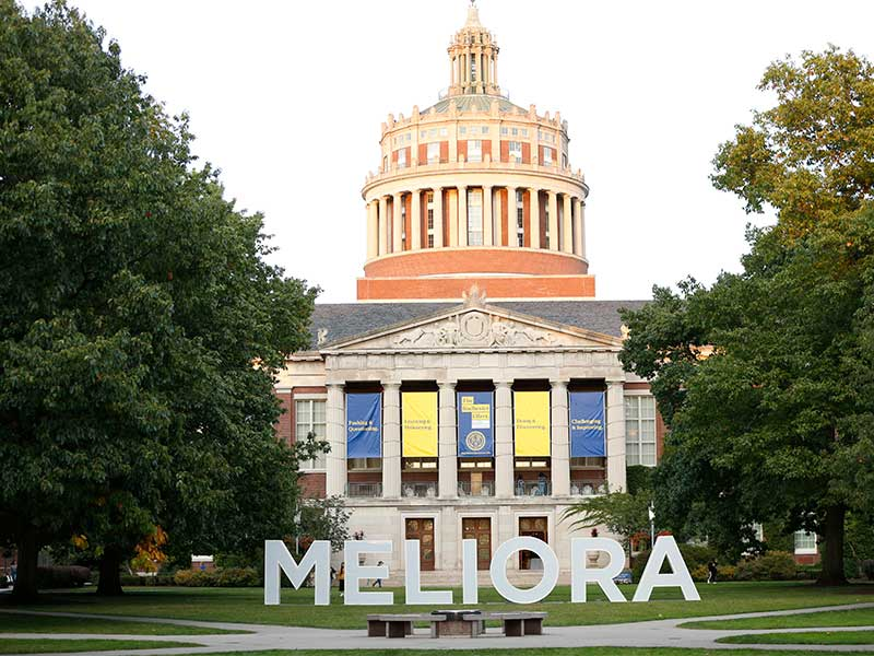 large MELIORA letters in quad in front of rush rhees library