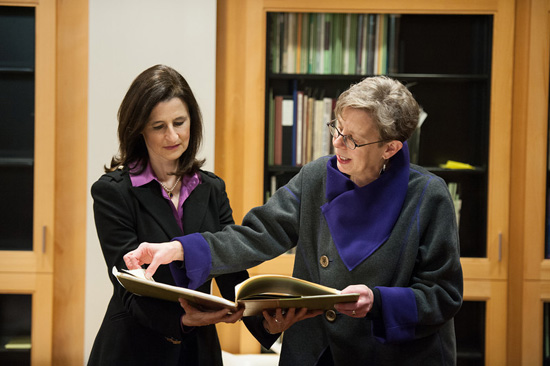 Nora Walter presents book to Mary Ann Mavrinac