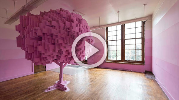 a pink tree-like structure made of blocks in a room painted pink