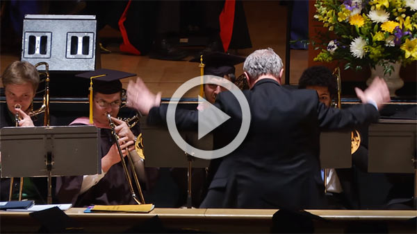 conductor leading grads in concert on stage