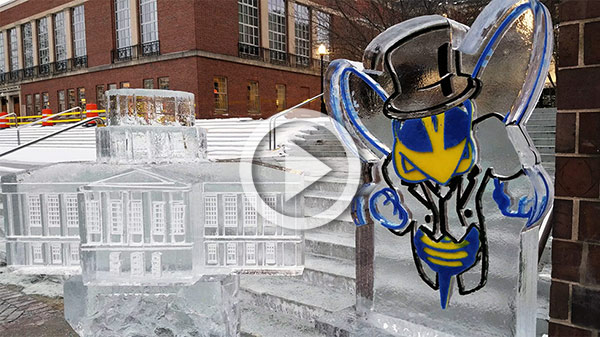 ice sculptures of mascot Rocky in a top hat and of Rush Rheel Library