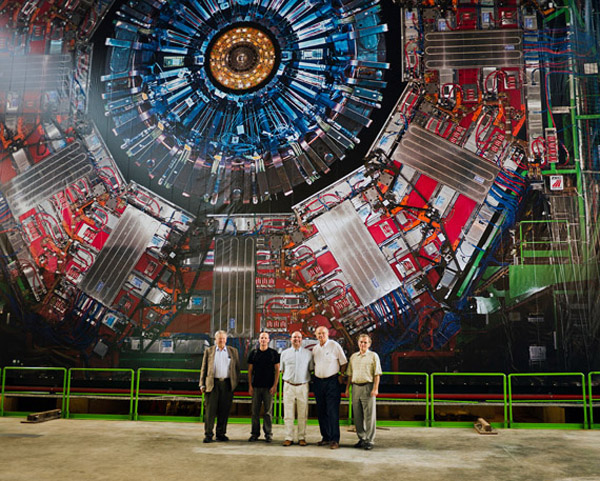 scientists in front of Large Hadron Collider