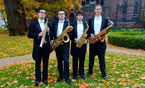 four men in tuxes with saxes