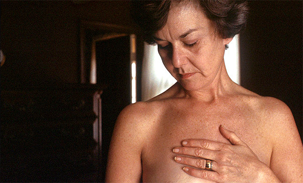 woman examining her chest