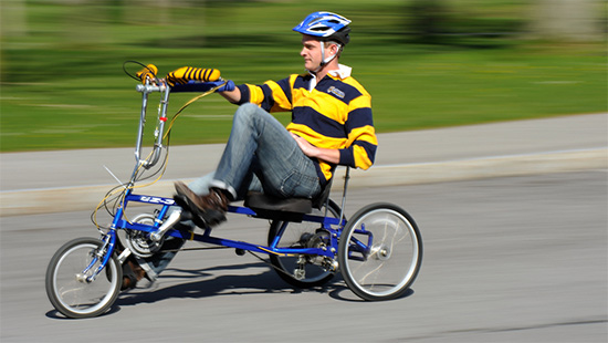 student riding modified trike