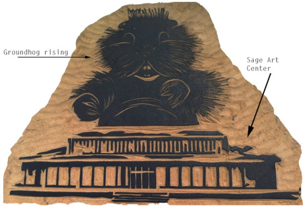 woodcut of a groundhog rising from the top of Sage Art Center