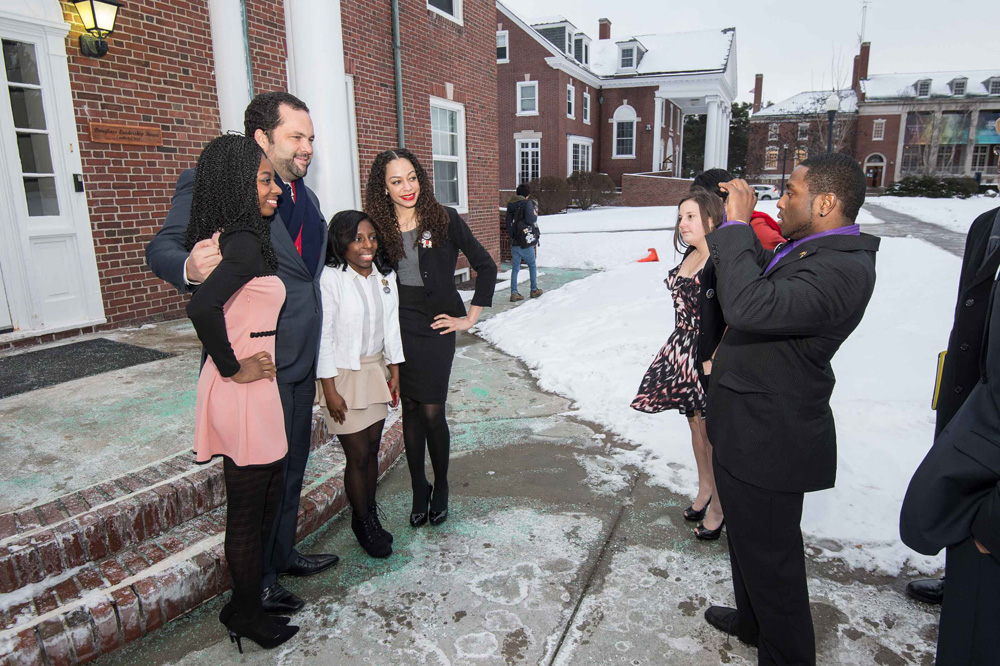 Benjamin Jealous poses for a photo with Rochester students