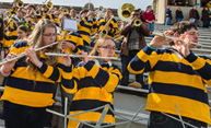 Pep Band musicians perform in football stadium