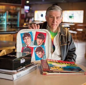 Ned Ferguson '66 with some of his Beatles memorabilia. (Andy Manis / AP Images for Rochester Review)