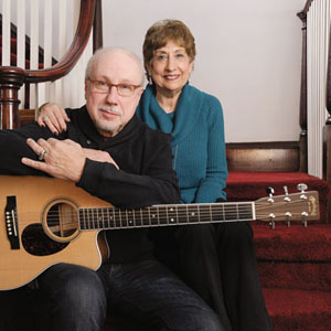 David '68 and Amy Zimmerman Freese '71 pose with guitar