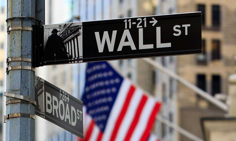 Wall St. sign and flags