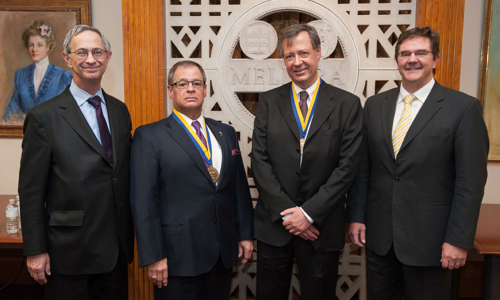 President Joel Seligman, Professor Robert L. McCrory, Professor Riccardo Betti and Dean Robert Clark,