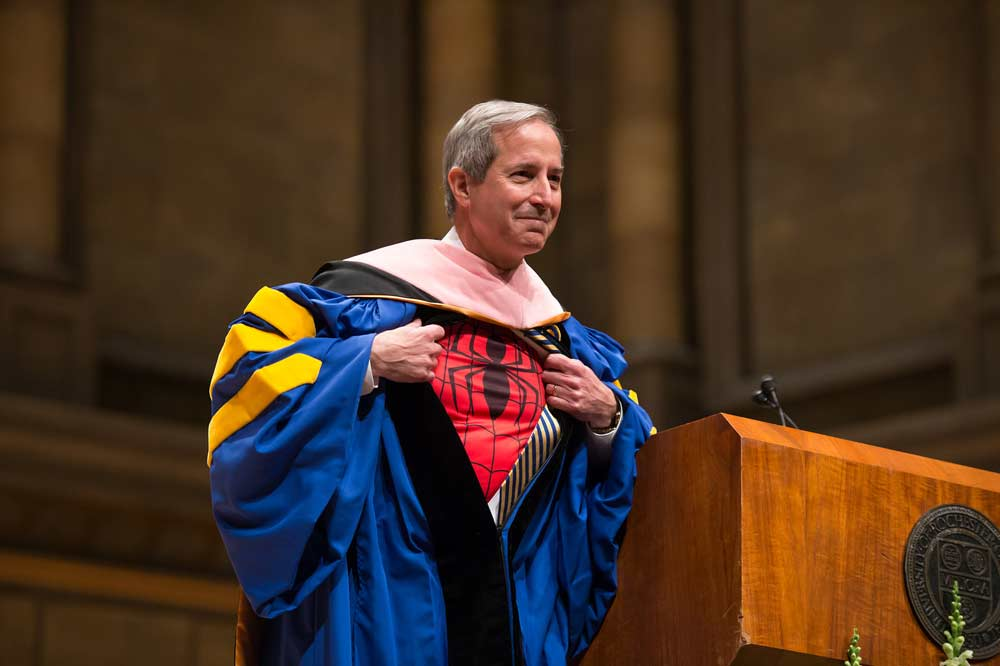 Dean Jamal Rossi wearing a Spider Man t-shirt under his academic regalia
