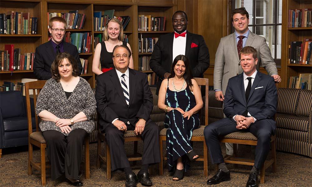 four grads and their teachers