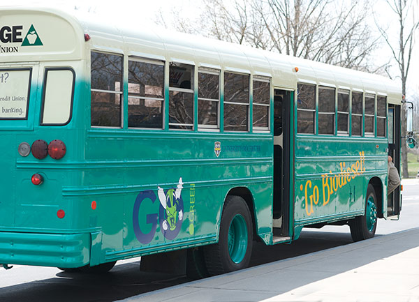 "teal colored bus with ""Go Biodiesel"" and ""Go Green"" signage"