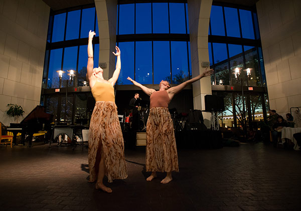 two women dancing in a spacious foyer