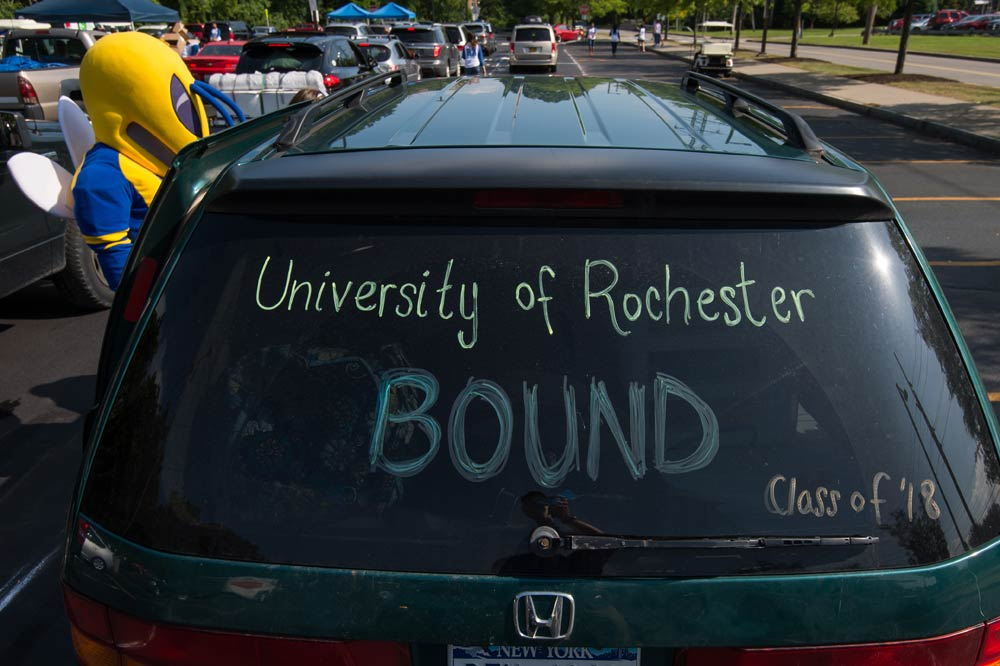 back windshield of a car reads University of Rochester Bound