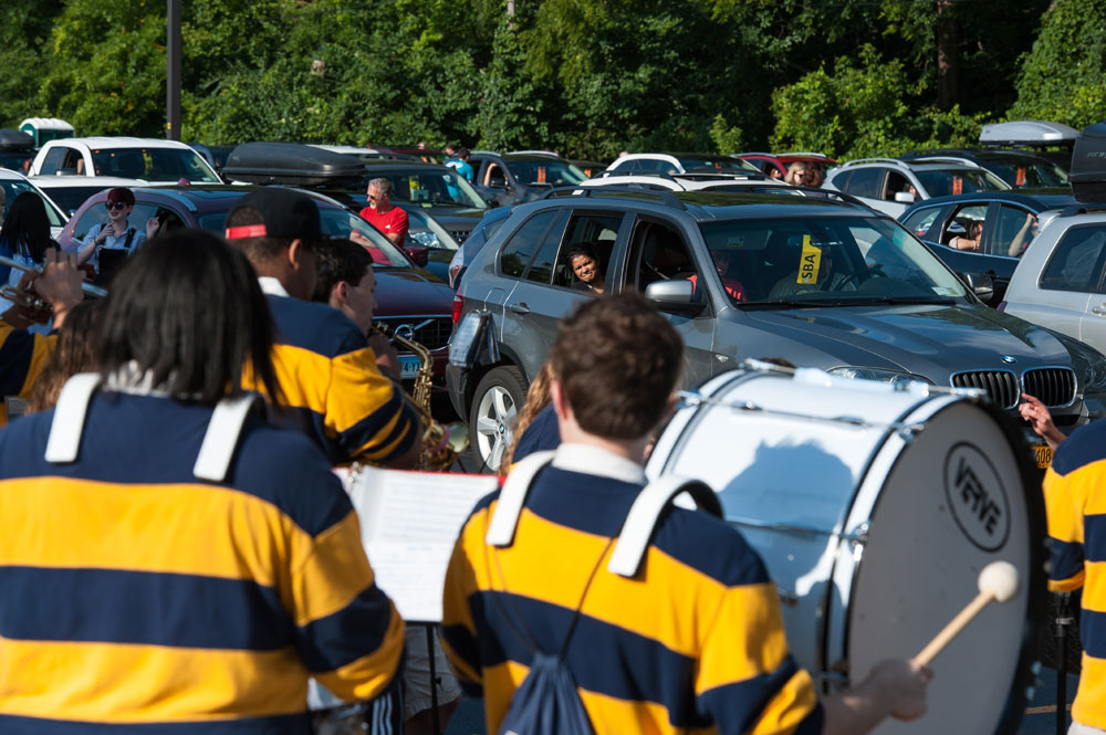 pep band musicians perform in parking lot