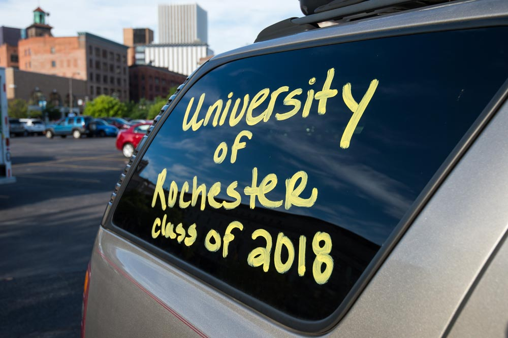 Window of car reads University of Rochester Class of 2018