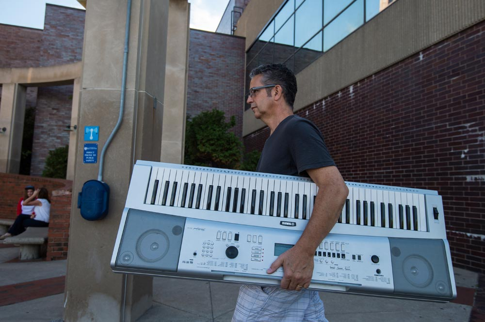 dd carrying an electronic keyboard