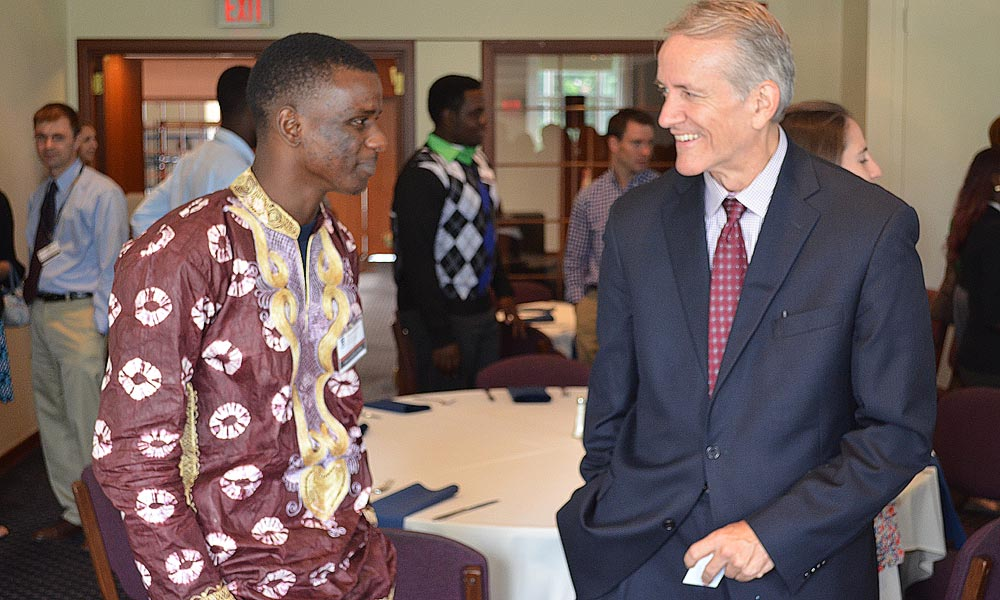 Jon Burdick at a reception with African student leaders