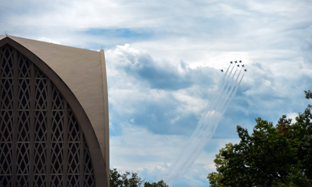 Air Force jets flying in close formation in the blue skies over the Interfaith Chapen