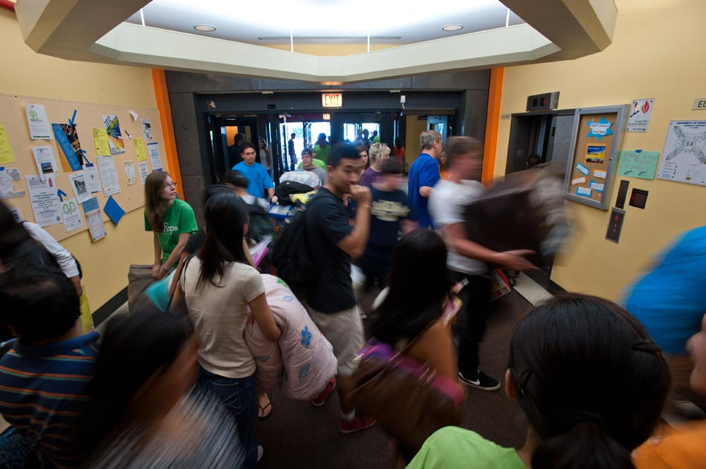 out-of-focus shot of swirling activity around the elevators in Susan B. Anthony Hall
