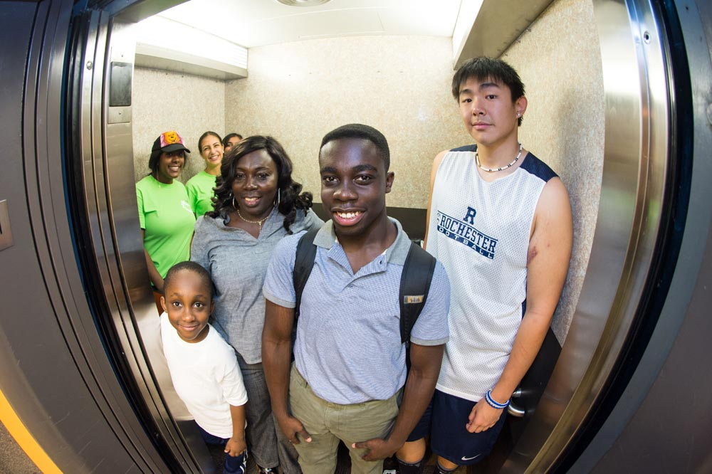 elevator packed with smiling students and families