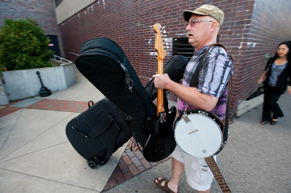 father carries a banjo and other instruments