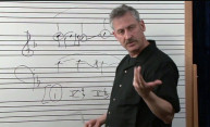 music prof showing music notation