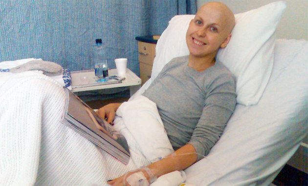 cancer patient in bed, smiling