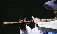 man playing Korean flute
