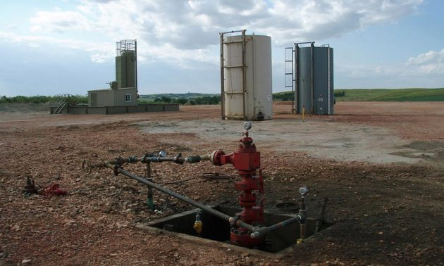 drilling well in a field