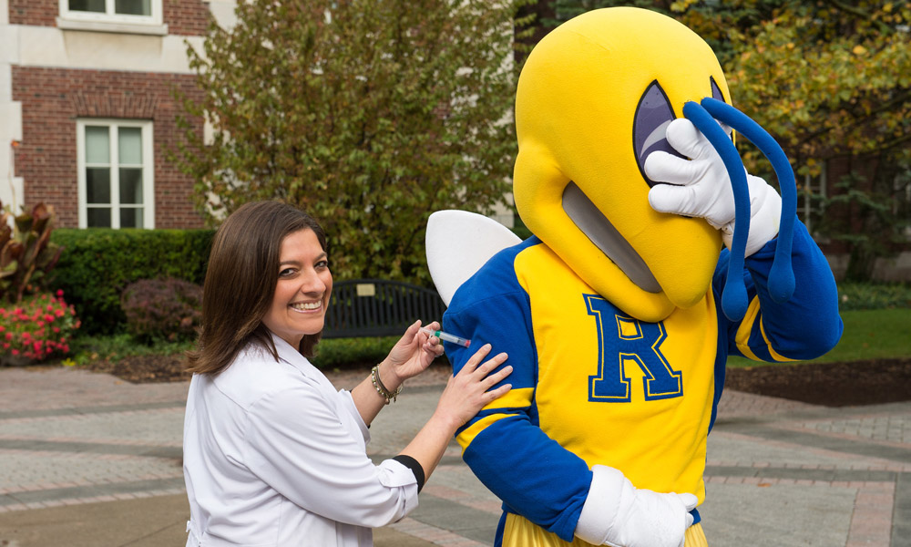 Rocky mascot getting a flu shot from a nurse