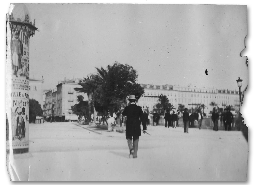historic photograph shows man in top hat walking away down a crowded street