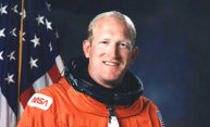 man in orange astronaut suit