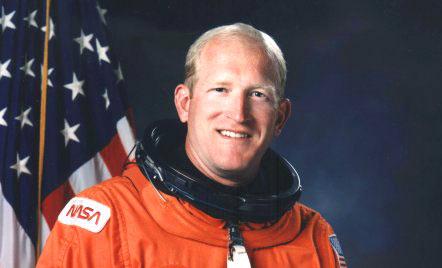 man in orange astronaut suit