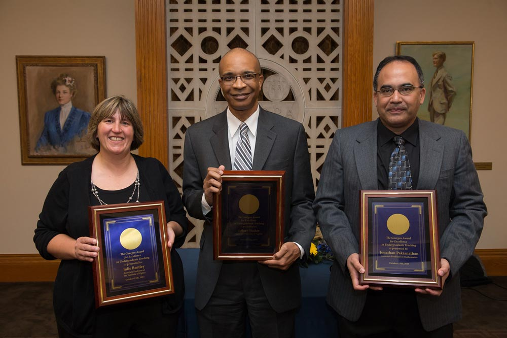Julie Bentley, Jeffrey Tucker, and Jonathan Pakianathan holding their teaching awards
