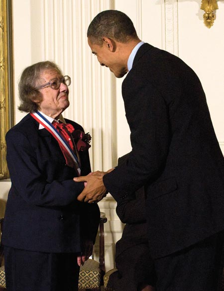 Esther Conwell shaking hands with President Obama.