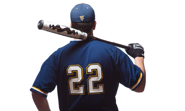 photo of a baseball player with a bat over his shoulder
