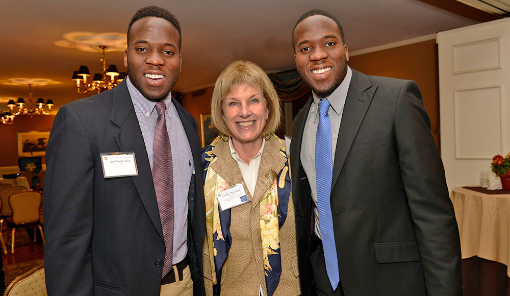 Cathy Minehan posing for a picture with two scholarship winners